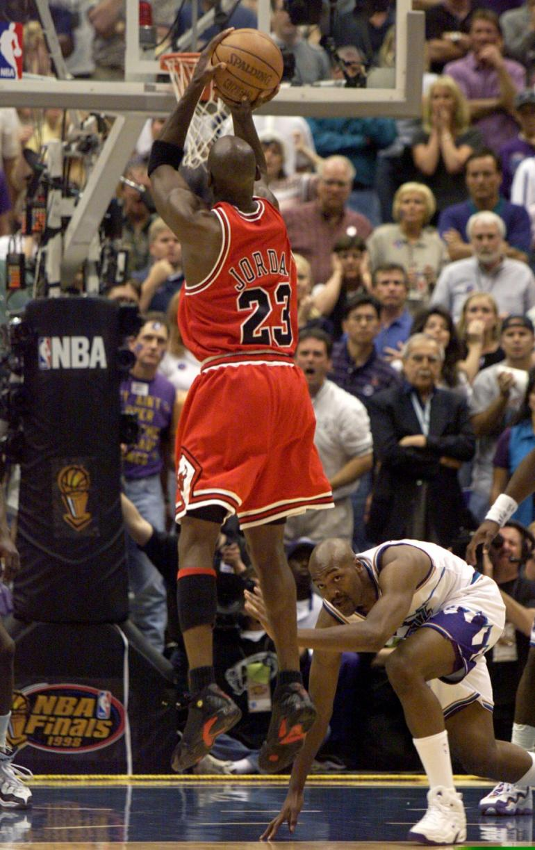 451681-chicago-bulls-michael-jordan-sinks-the-championship-winning-basket-as-